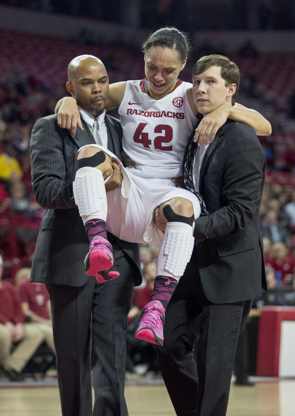 Arkansas forward Jhasmin Bowen, center, is lifted from the court after being injured during the second half of an NCAA college basketball game Thursday, Feb. 26, 2015, in Fayetteville, Ark. Kentucky defeated Arkansas 56-51. (AP Photo/Gareth Patterson)