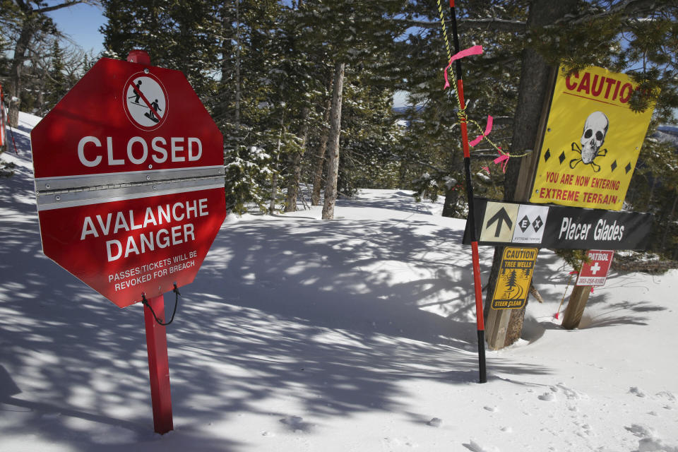 FILE- In this Feb. 26, 2014, file photo, a sign alerts skiers to danger on Corona Bowl, known for its extreme skiing, at Eldora Mountain Resort, near Nederland, Colo. This has been an highly dangerous avalanche season, with 30 confirmed fatalities. It's involved different recreational activities — snowboarding, skiing, snowmobiling, hiking — and includes various ages and experience levels. A warning from avalanche experts for anyone venturing into the backcountry: The threat of slides may only be growing worse. (AP Photo/Brennan Linsley, File)