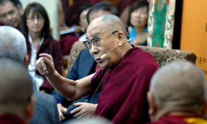 """<span class=""""caption"""">The Dalai Lama speaks about quantum effects with Chinese scientists at the Main Tibetan Temple, Nov. 1, 2018, in Dharamshala, India. </span> <span class=""""attribution""""><a class=""""link rapid-noclick-resp"""" href=""""https://www.gettyimages.com/detail/news-photo/tibetan-spiritual-leader-the-dalai-lama-delivers-his-news-photo/1056118136?adppopup=true"""" rel=""""nofollow noopener"""" target=""""_blank"""" data-ylk=""""slk:Shyam Sharma/Hindustan Times via Getty Images"""">Shyam Sharma/Hindustan Times via Getty Images</a></span>"""