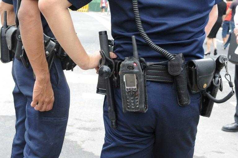 Police stand guard in Singapore on July 18, 2012