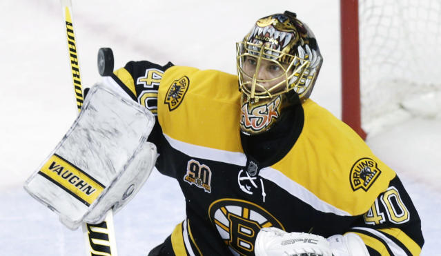 Boston Bruins goalie Tuukka Rask (40) keeps his eyes on the puck as he makes a save against the Montreal Canadiens during the second period of Game 1 in the second-round of a Stanley Cup playoff series in Boston, Thursday, May 1, 2014. (AP Photo/Charles Krupa)