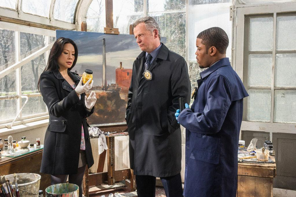 """The Woman"" - Captain Gregson (Aidan Quinn, center) Joan (Lucy Liu) and Det. Bell (Jon Michael Hill, right) once again find themselves in the crosshairs of the enigmatic Moriarty, on the two hour season finale of ""Elementary."""