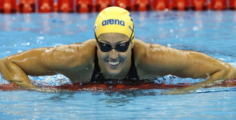 Sweden's Therese Alshammar smiles after a women's 50m Freestyle heat at the FINA Swimming World Championships in Shanghai, China, Saturday, July 30, 2011.  (AP Photo/Wong Maye-E)