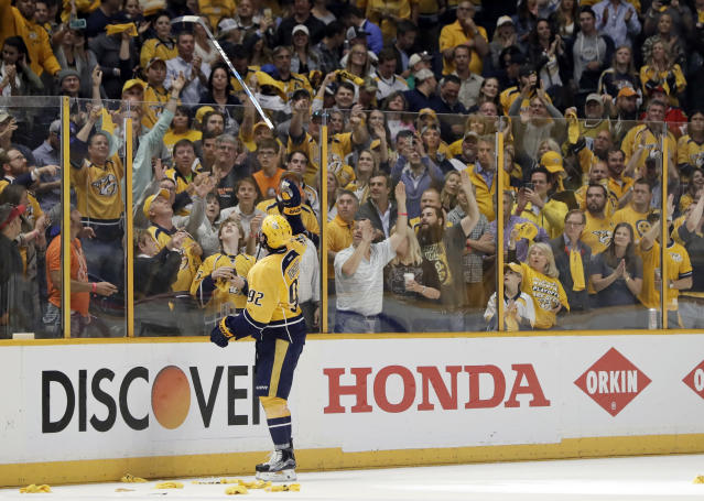 Nashville Predators center Ryan Johansen (92) tosses his stick to the fans after the Predators defeated the Chicago Blackhawks 4-1 in Game 4 of a first-round NHL hockey playoff series Thursday, April 20, 2017, in Nashville, Tenn. The Predators swept the series. (AP Photo/Mark Humphrey)