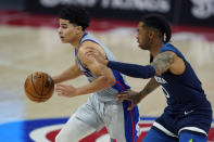 Detroit Pistons guard Killian Hayes drives as Minnesota Timberwolves guard D'Angelo Russell (0) defends during the second half of an NBA basketball game, Tuesday, May 11, 2021, in Detroit. (AP Photo/Carlos Osorio)