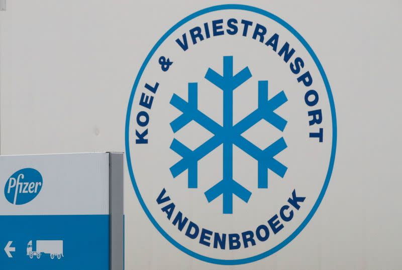 A logo is seen on a refrigerated truck leaving the Pfizer plant in Puurs