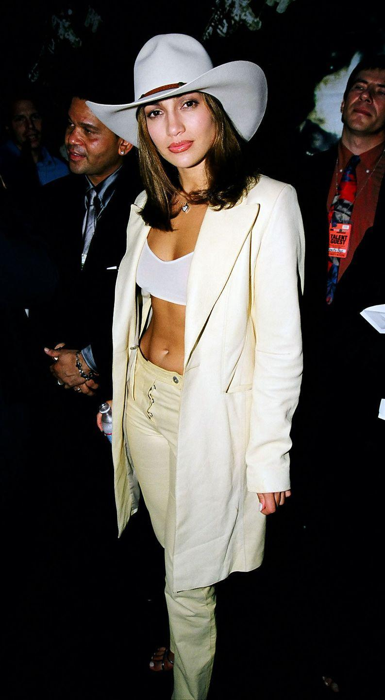 <p>This was more than a decade before <em>Old Town Road</em> dominated the charts, but J.Lo was way ahead of the Western game in this cowboy hat and pantsuit combo at the '98 awards. </p>
