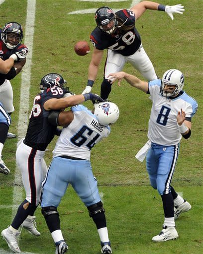 Tennessee Titans quarterback Matt Hasselbeck (8) throws a pass as Leroy Harris (64) blocks Houston Texans' Brian Cushing (56) in the first quarter of an NFL football game on Sunday, Jan. 1, 2012, in Houston. (AP Photo/Dave Einsel)