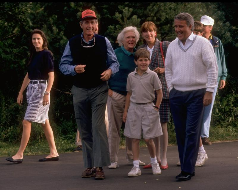 <p>Bush and Mulroney lead their families for a stroll on Aug. 31, 1989. Both fathers had children that followed their footsteps by entering politics, including Caroline Mulroney, who can be spotted on the left. Photo from Getty Images. </p>