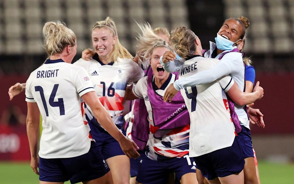 Ellen White goes wild with her team-mates after making it 2-1 to Great Britain - REUTERS
