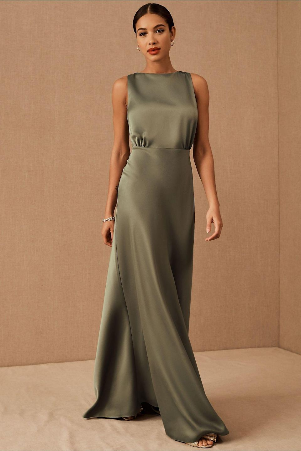"""This high-neck floor-length silk dress is—in a word—timeless. $220, BHLDN. <a href=""""https://www.bhldn.com/products/beckett-satin-charmeuse-dress-sedona-sunset?color=Moss&size_type=plus&via=Z2lkOi8vdXJibi9Xb3JrYXJlYTo6Q2F0YWxvZzo6Q2F0ZWdvcnkvQzlCRDc3ODg"""" rel=""""nofollow noopener"""" target=""""_blank"""" data-ylk=""""slk:Get it now!"""" class=""""link rapid-noclick-resp"""">Get it now!</a>"""