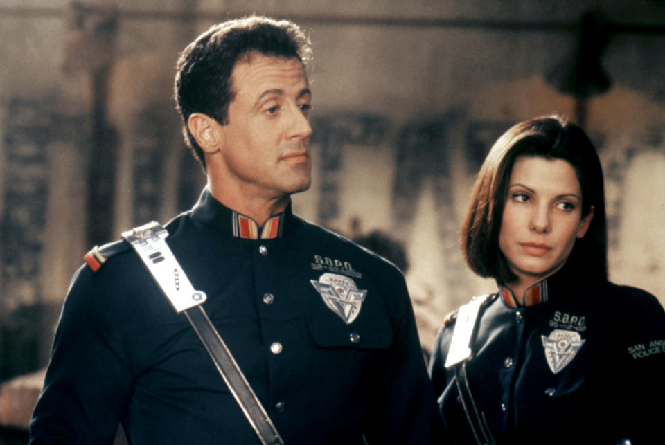 American actors Sylvester Stallone and Sandra Bullock on the set of <Demolition Man> directed by Marco Brambilla. (Photo by Sunset Boulevard/Corbis via Getty Images)