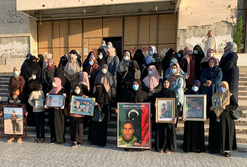 Women protest against what they is lack of government support after losing their husbands or children in the fighting, in Misrata