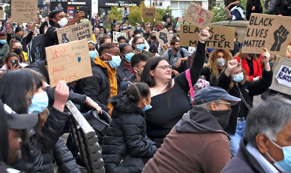 Protesters hold placards during the demonstration. Hundreds of people turned out in Bedford town centre, to hold a peaceful demonstration as part of a worldwide Black Lives Matter solidarity Protest triggered by the death of George Floyd, while in police custody. (Photo by Keith Mayhew / SOPA Images/Sipa USA)