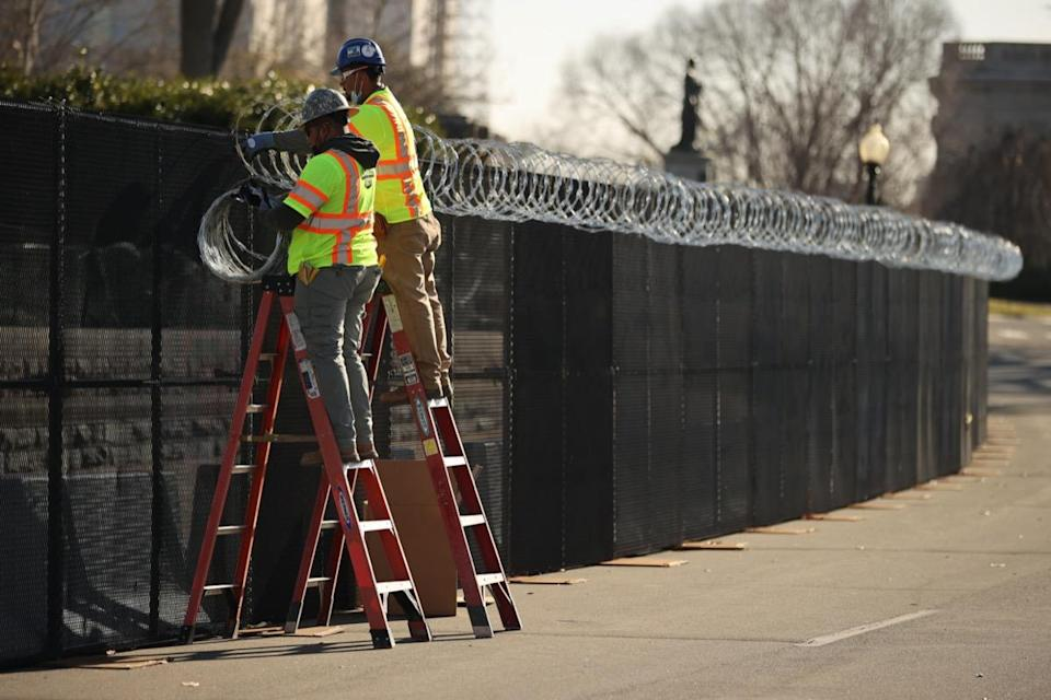 workers install razor wire outside us capitol