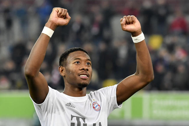 Bayern's David Alaba celebrates after the German Bundesliga soccer match between Fortuna Duesseldorf and FC Bayern Munich in Duesseldorf, Germany, Saturday, Nov. 23, 2019. (AP Photo/Martin Meissner)