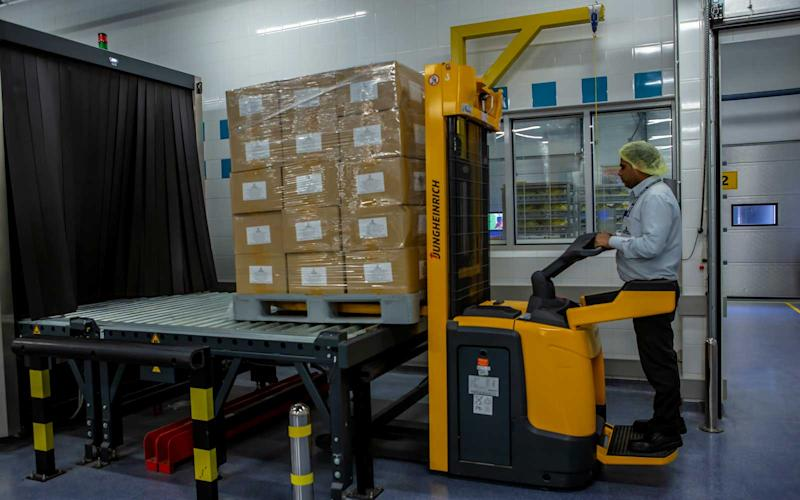 Products coming into the facility are scanned and sent through for storage. | Talia Avakian