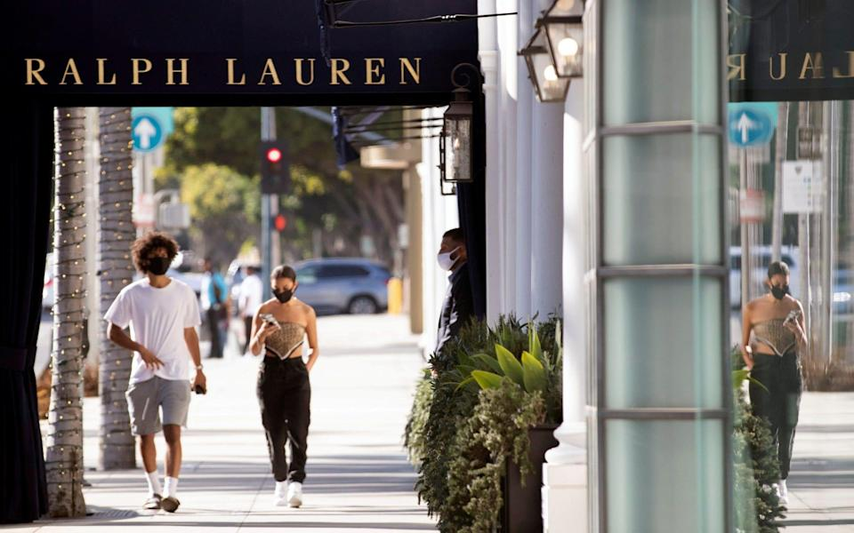 A security guard stands outside the Ralph Lauren store in Beverly Hills - Mario Anzuoni/REUTERS