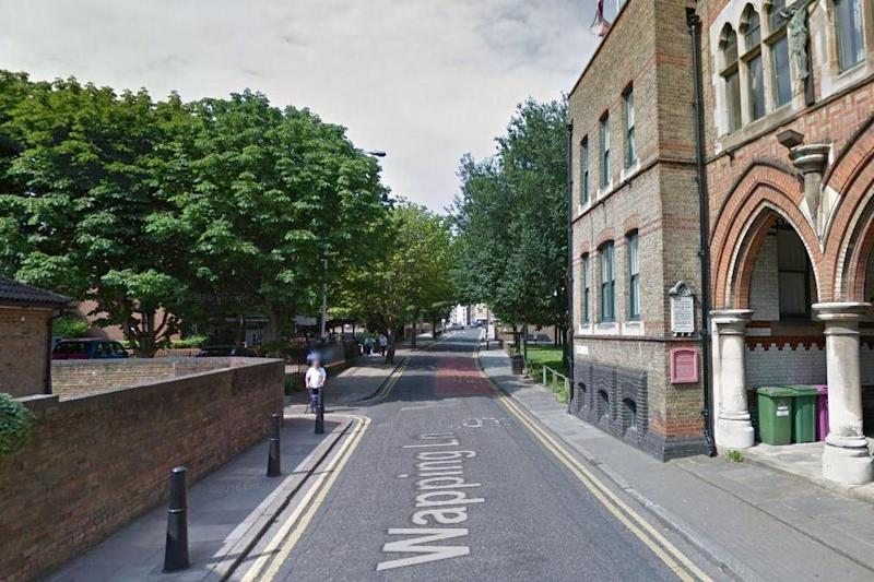 Street attack: The man was found lying in Wapping Lane, east London: Google Streetview