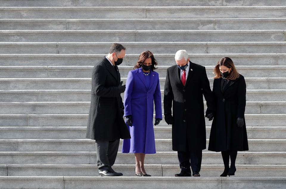 Former U.S. Vice President Mike Pence and his wife Karen and U.S. Vice President Kamala Harris and her husband Doug Emhoff walk down the stairs after the inauguration of Joe Biden as the 46th President of the United States, in Washington on January 20, 2021. (Mike Segar/Reuters)
