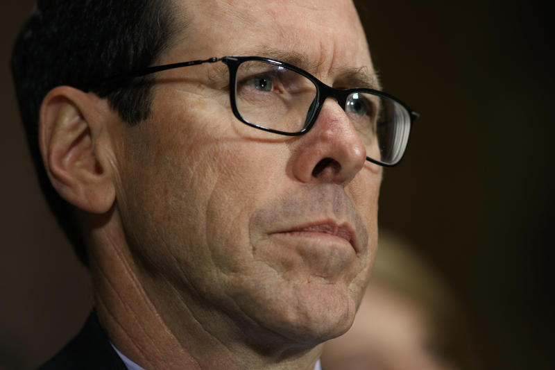 AT&T $1,000 tax bonus came after exchange with union head