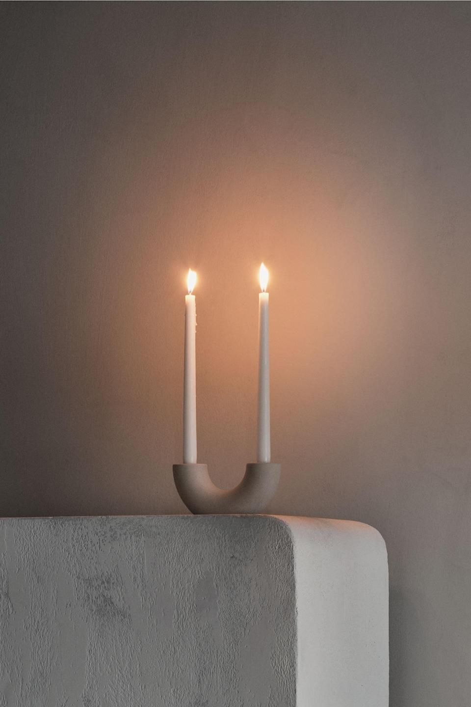 <p>The shape of this <span>Ceramic Candlestick</span> ($18) makes it quirky, bringing lots of personality to the surface you place it on. We love the elevated look. </p>