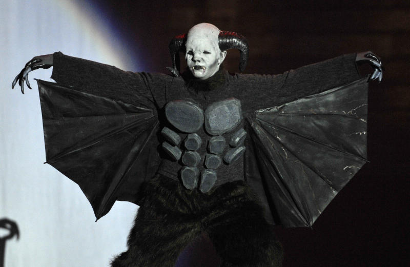 Jake Webber shows off his Batwolf costume in a skit at the 2013 Comic-Con International Masquerade on Wednesday, July 20, 2013 in San Diego. (Photo by Jack Dempsey/Invision/AP)