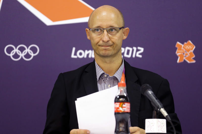 "Chief Operating Officer Thomas Lund, of the Badminton World Federation, speaks during a news conference announcing the elimination of eight female badminton doubles players at the 2012 Summer Olympics, Wednesday, Aug. 1, 2012, in London. The Badminton World Federation announced its ruling after investigating two teams from South Korea and one each from China and Indonesia. It punished them for ""not using one's best efforts to win a match"" and ""conducting oneself in a manner that is clearly abusive or detrimental to the sport"" in matches Tuesday night. (AP Photo/Markus Schreiber)"