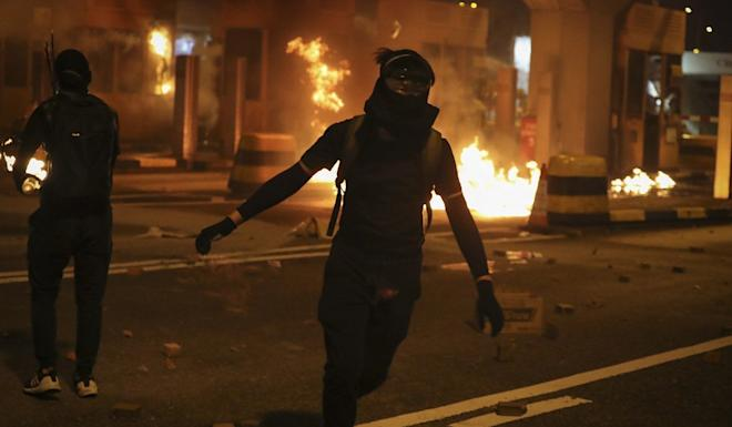 Toll booths on the Hung Hom side of the Cross-Harbour Tunnel were pelted with petrol bombs. Photo: AP