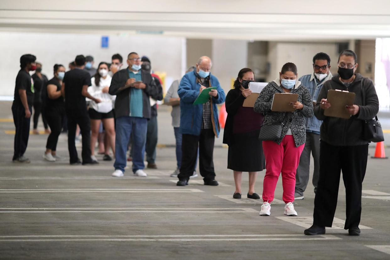 People wait for coronavirus disease (COVID-19) vaccinations, in Los Angeles, California on April 12, 2021. (Lucy Nicholson/Reuters)