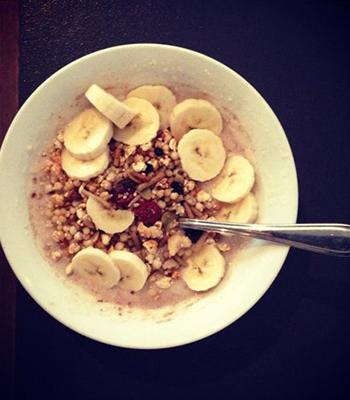 """""""I usually munch my breakfast while reading something online or in a magazine; porridge with blueberries, banana and organic milk. I like to have a Black coffee with stevia around 9am while I do my makeup and pack my bag."""" Brekkie Trifle recipe"""