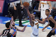 Denver Nuggets guard PJ Dozier (35) shoots between Oklahoma City Thunder center Mike Muscala (33), guard Ty Jerome (16) and guard Theo Maledon (11) during the second half of an NBA basketball game Saturday, Feb. 27, 2021, in Oklahoma City. (AP Photo/Sue Ogrocki)