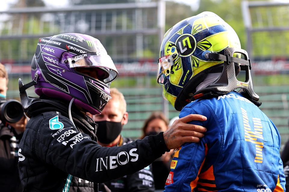 IMOLA, ITALY - APRIL 18: Second placed Lewis Hamilton of Great Britain and Mercedes GP and third placed Lando Norris of Great Britain and McLaren F1 hug in parc ferme during the F1 Grand Prix of Emilia Romagna at Autodromo Enzo e Dino Ferrari on April 18, 2021 in Imola, Italy. (Photo by Bryn Lennon/Getty Images)