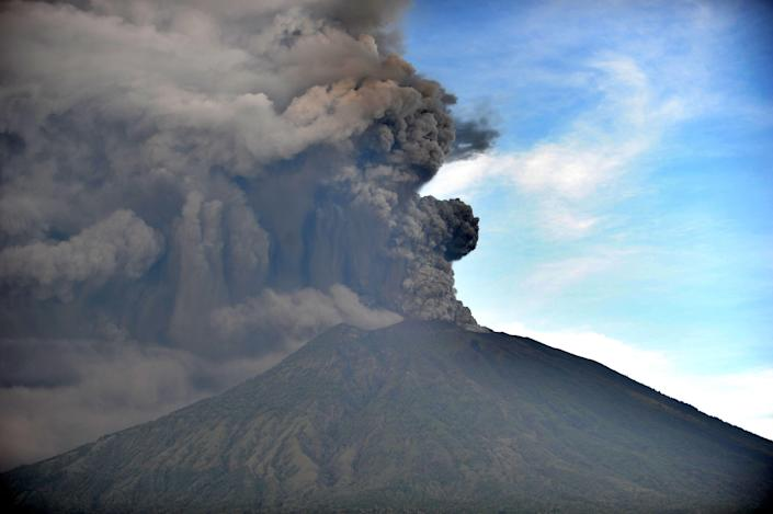 <p>General view of Mount Agung during an eruption seen from Kubu sub-district in Karangasem Regency, on Indonesia's resort island of Bali on Nov. 26, 2017. (Photo: Sonny Tumbelaka/AFP/Getty Images) </p>