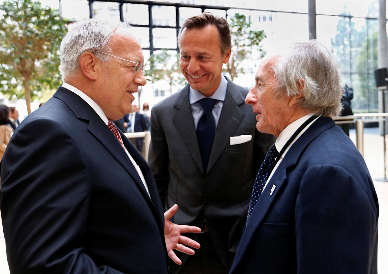 Swiss President Johann Schneider-Ammann talks with former F1 pilot Jackie Stewart (R) and businessman Ernesto Bertarelli at the Campus Biotech, during the State visit of Portuguese President Marcelo Rebelo de Sousa in Geneva, Switzerland October 17, 2016. REUTERS/Denis Balibouse