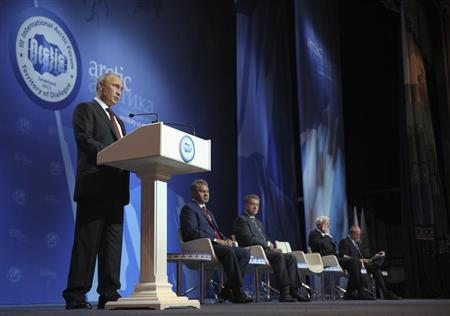 Russia's President Putin delivers a speech during the III International Arctic forum in Salekhard