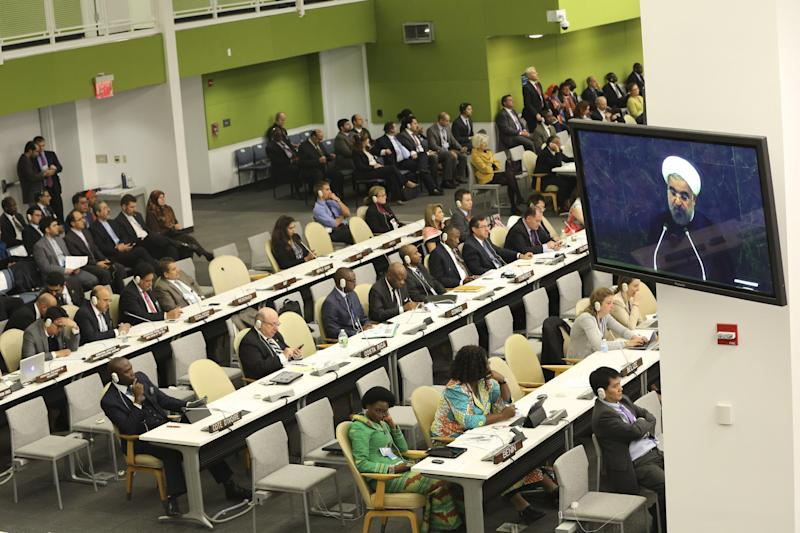 Iranian President Hasan Rouhani is seen on a television monitor as he addresses the 68th session of the United Nations General Assembly, Tuesday, Sept. 24, 2013 at U.N. headquarters. (AP Photo/Mary Altaffer)