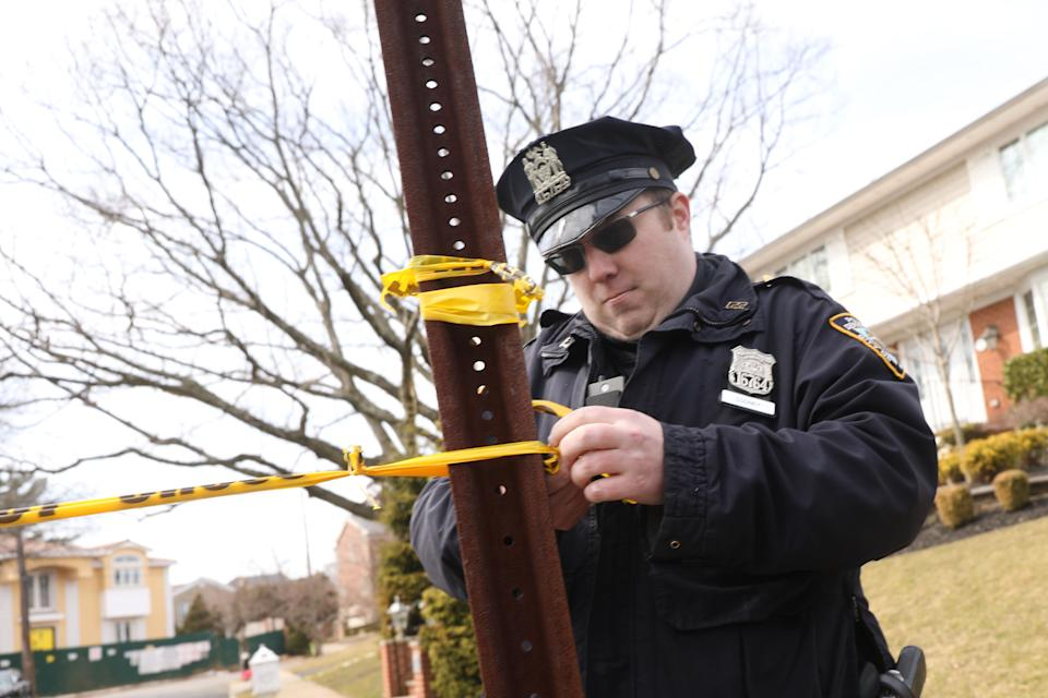 "NEW YORK, NEW YORK - MARCH 14: Police stand near where reputed mob boss Francesco ""Franky Boy"" Cali lived and was gunned down on March 14, 2019 in the Todt Hill neighborhood of the Staten Island borough of New York City. Cali, 53, was a top leader of New York's notorious Gambino crime family, according to federal prosecutors. He was shot and killed Wednesday by an unidentified assailant just after 9 p.m., according to police. (Photo by Spencer Platt/Getty Images)"