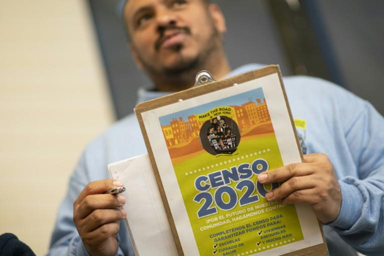 Douglas Carrasquel, who works with the group Make the Road New York, makes about 200 calls every day urging people to take part in the US Census