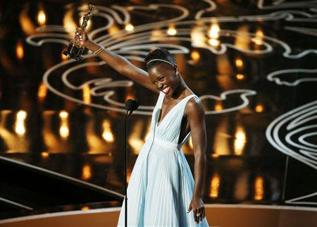 """Nyong'o, best supporting actress winner for her role in """"12 Years a Slave"""", speaks on stage at the 86th Academy Awards in Hollywood"""