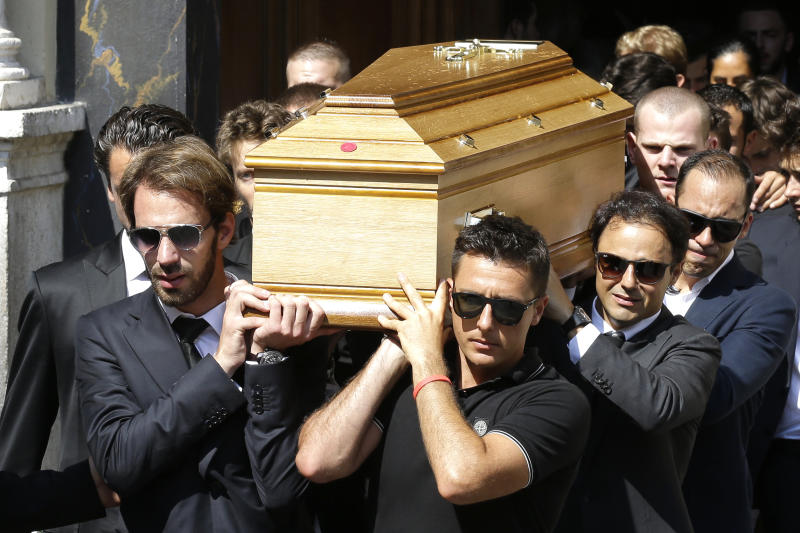 French Formula One driver Jean Eric Vergne, left, Brazilian Formula One driver Felipe Massa, second right, and Venezuelan Formula One driver Pastor Maldonado, right, carry the casket of French Formula One driver Jules Bianchi into Sainte Reparate Cathedral during his funeral in Nice, French Riviera, Tuesday, July 21, 2015. Bianchi, 25, died Friday from head injuries sustained in a crash at last year's Japanese Grand Prix. He had been in a coma since the Oct. 5 accident, in which he collided at high speed with a mobile crane which was being used to pick up another crashed car. (AP Photo/Lionel Cironneau)