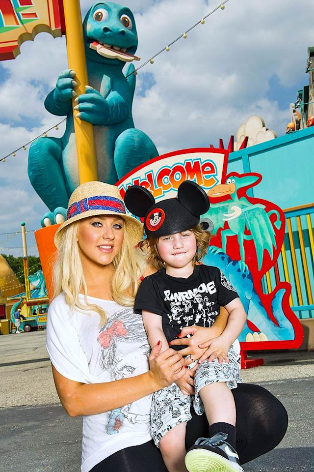 """Former Mickey Mouse Club member Christina Aguilera returned to her roots Monday when she took her son Max to Walt Disney World Florida's Animal Kingdom theme park. The singer's divorce from Jordan Bratman, her husband of nearly five years, was officially granted Friday by the Los Angeles Superior Court. Disney/<a href=""""http://www.splashnewsonline.com"""" target=""""new"""">Splash News</a> - April 11, 2011"""