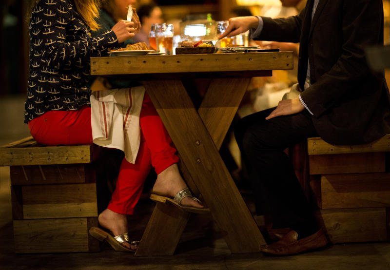 CHARLESTON, SC - MARCH 11: A couple eat dinner in the outdoor dinning area at Edmund's Oast in Charleston, South Carolina on Wednesday, March 11, 2015. (Photo by Melina Mara/The Washington Post via Getty Images)