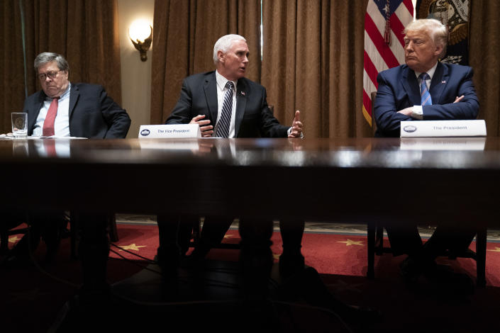FILE - In this June 15, 2020, file photo Attorney General William Barr, left, and President Donald Trump listen as Vice President Mike Pence speaks during a roundtable about America's seniors, in the Cabinet Room of the White House in Washington. Barr is scheduled to appear for the first time before the House Judiciary Committee on Tuesday, July 28. (AP Photo/Evan Vucci, File)