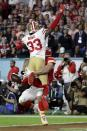 San Francisco 49ers' Tarvarius Moore (33) is called for pass interference on Kansas City Chiefs' Travis Kelce during the second half of the NFL Super Bowl 54 football game Sunday, Feb. 2, 2020, in Miami Gardens, Fla. (AP Photo/Lynne Sladky)