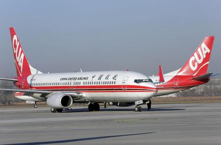 FILE PHOTO: Boeing 737 jets of China United Airlines are seen at the Nanyuan Airport in Beijing