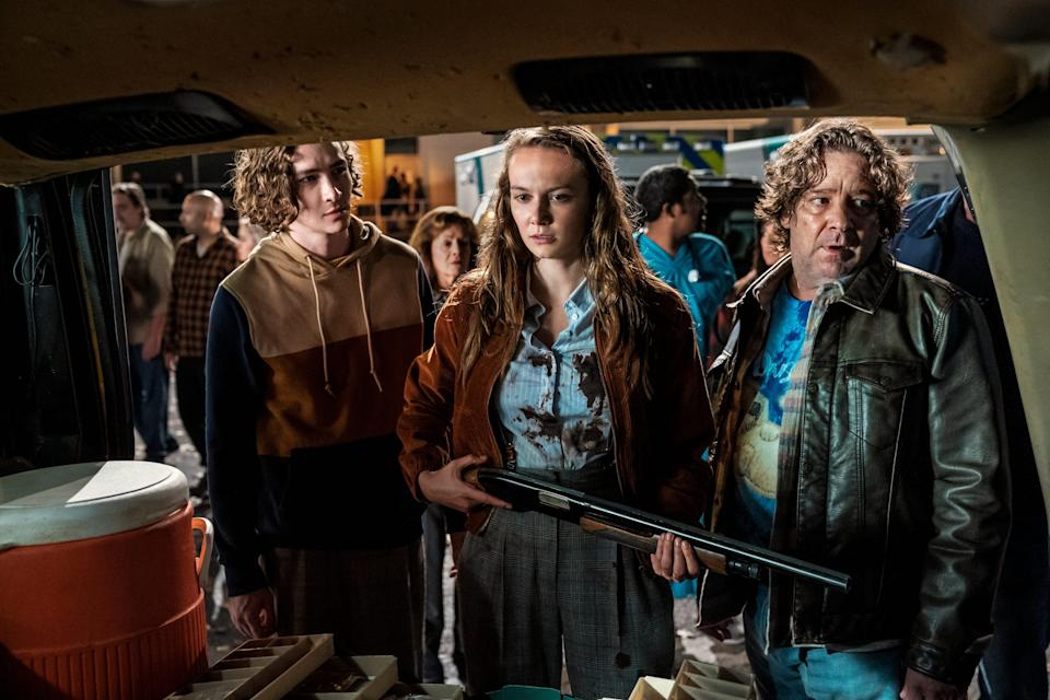 """Allyson (Andi Matichak, center, with Dylan Arnold and Robert Longstreet) joins the local posse formed to hunt down Michael Myers in """"Halloween Kills."""""""