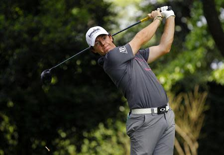 Rory McIllroy of Northern Ireland hits his tee shot on the second hole during a practice round for the 2012 Masters Golf Tournament at the Augusta National Golf Club in Augusta