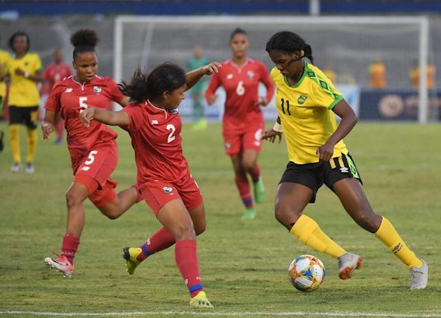 Jamaican striker Khadija Shaw (R) is one of the stars of the Reggae Girlz (AFP Photo/Angela Weiss)