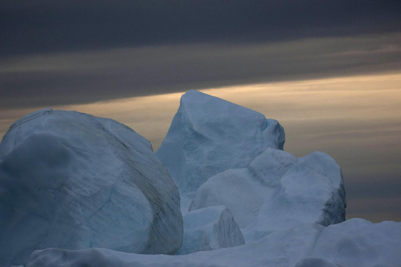 In this July 18, 2011 photo, a large iceberg shed from the Greenland ice sheet floats near Ilulissat, Greenland. (AP Photo/Brennan Linsley)